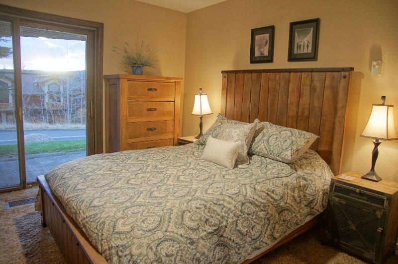 Bedroom 2 has a Queen bed and patio
