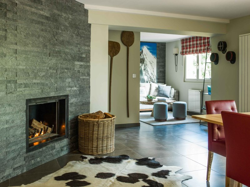 The living area also includes dining area, log fire & reading snug