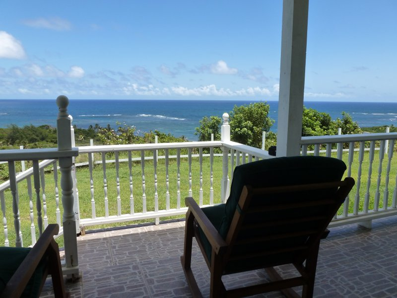 Caribbean styled cottage with spectacular ocean views and cool tropical breeze, vacation rental in Nevis