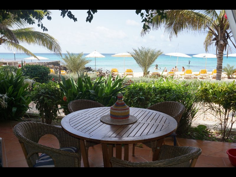 Seating on the patio over looking beach and sea