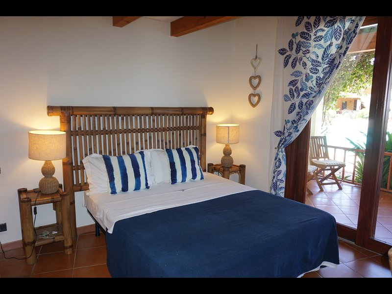 Bedroom 1  King size bed  French doors onto patio Sea, beach pool views