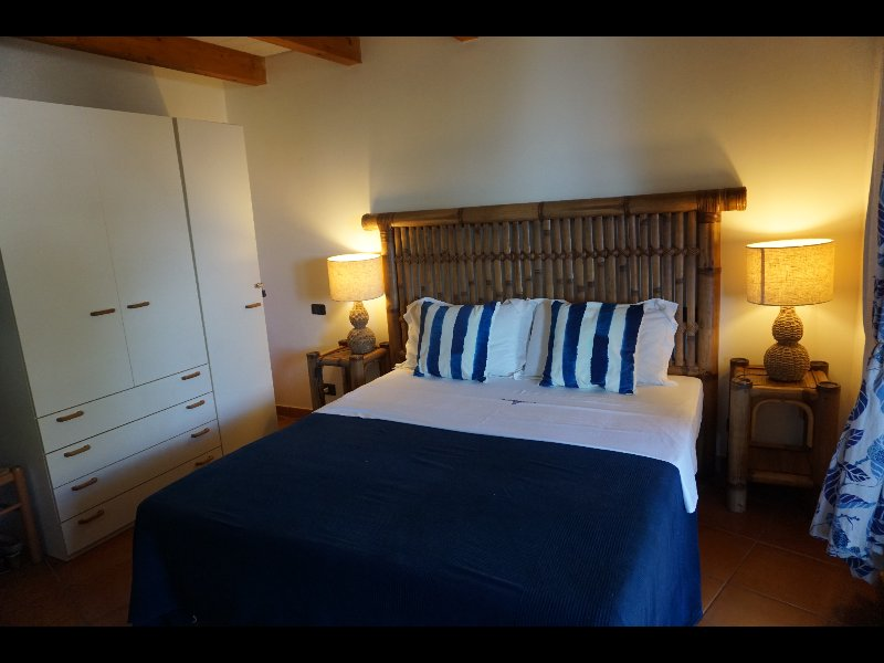 Bedroom 1  Kingside bed French doors leading onto patio with full sea, beach, pool views