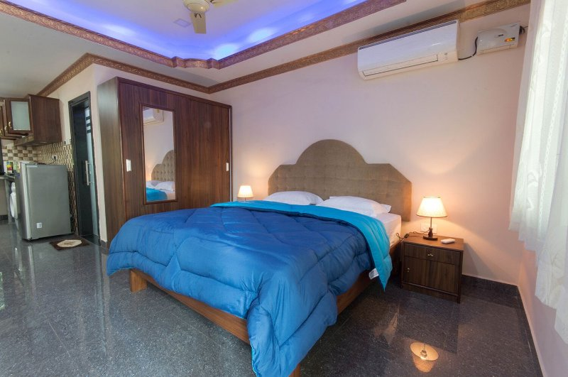 Spacious apartment with beautifully lit bedroom, sofas, balcony, AC, wardrobe, washing machine