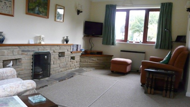 Another view of the living room and fireplace