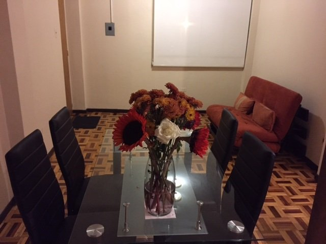 Dinning table for 4 and living area with futon