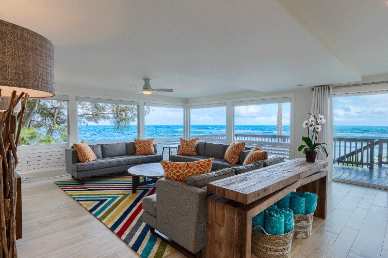 Living room with direct ocean views.