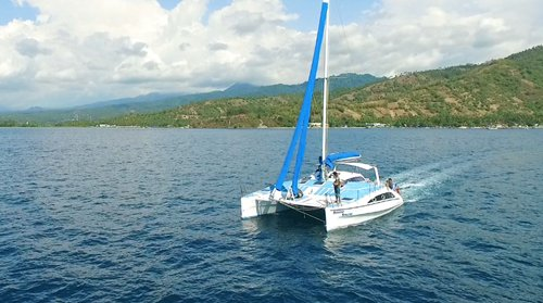 Catamaran Boat Charter, Fishing,Snorkling & Floating sunset around the island