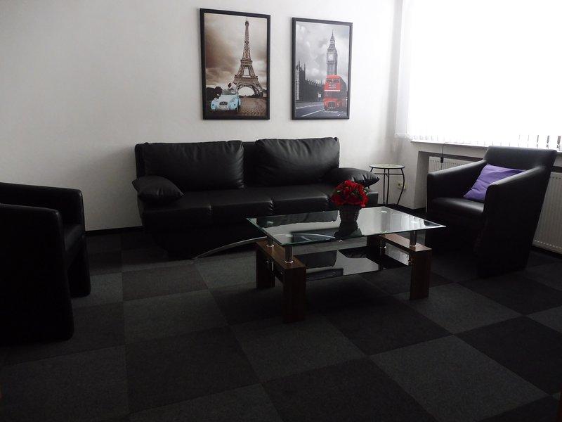 sala de estudio con sofá cama