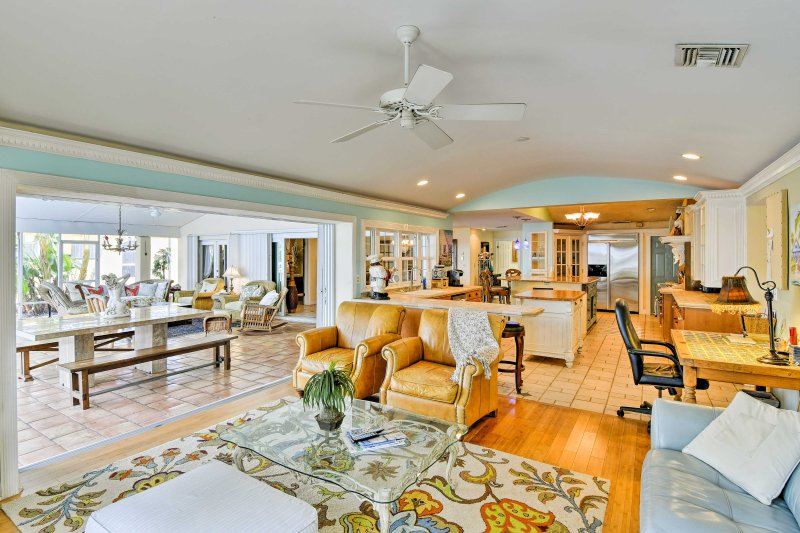 This open-concept living room is filled with lavish decor & plenty of character.