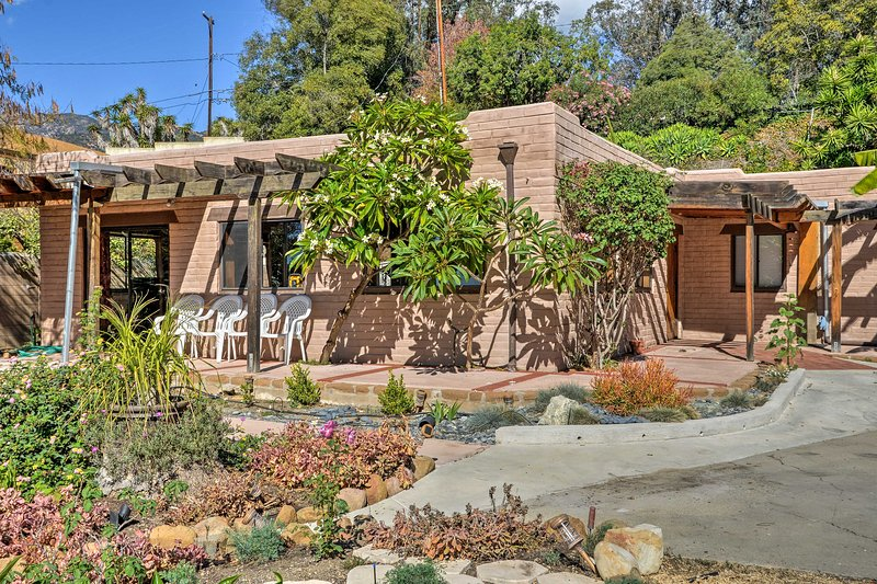Escape to a hideaway high above the Sycamore Canyon when you travel to this vacation rental house in Montecito!