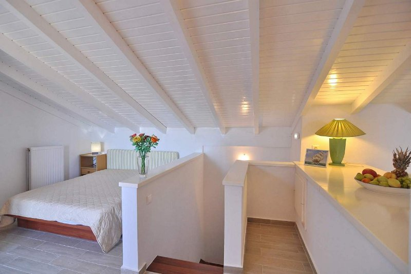 Loft with double bed and shower bathroom along with private balcony with panoramic views.