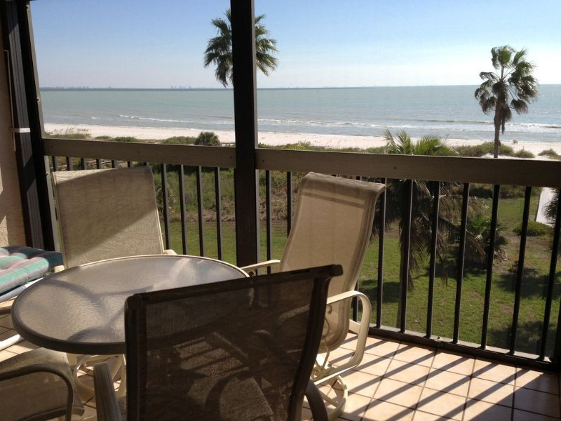 DIRECT OCEAN VIEW ON TOP FLOOR WITH SCREENED PORCH ENJOYING SUNRISE, WITH COFFEE AND LIGHT BREEZE.