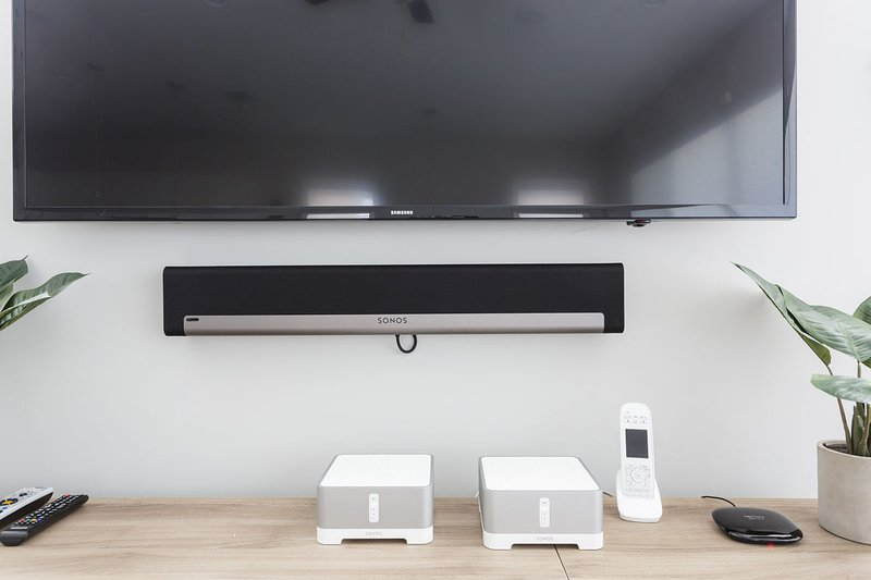 Flat screen TV and Sonos Sound System