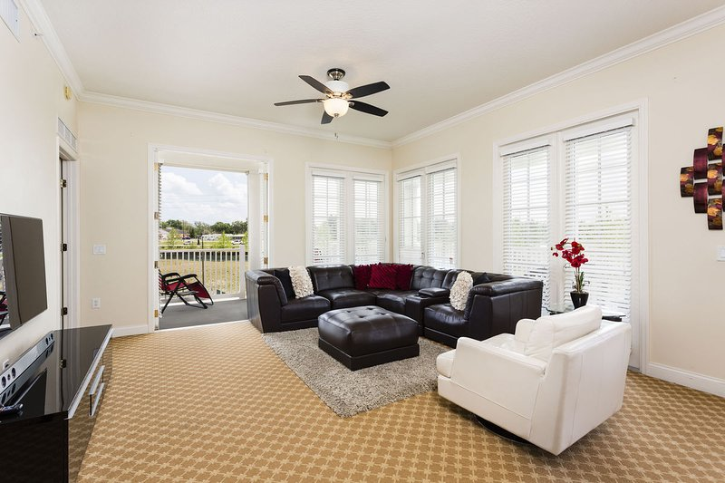 Beautiful living room complete with high speed wireless internet and overhead fan