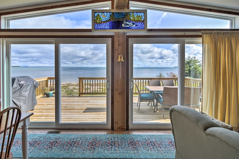 Magnificent views overlook Lake Huron from inside and outside the property.