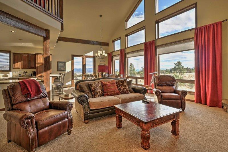 This home boasts rustic wood beams, vaulted ceilings & floor-to-ceiling windows.