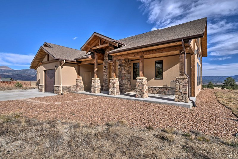 You'll never be able to escape the mountains at this stunning Colorado home!