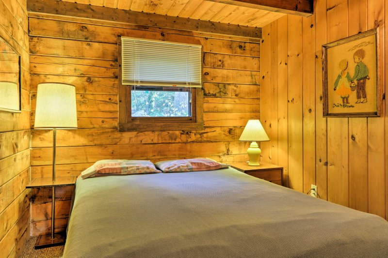 The cozy second bedroom creates a peaceful sleeping environment.