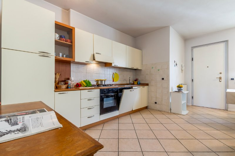 Kitchen with dishwasher, cooker hob and oven.
