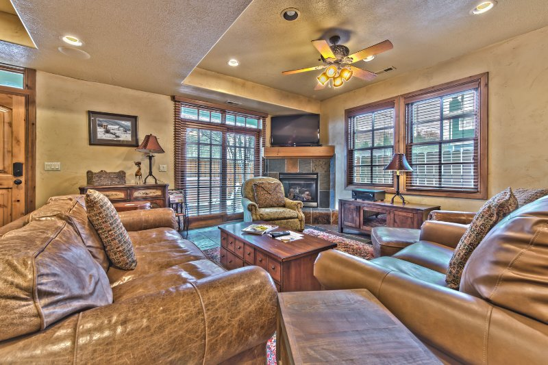 Entry into Living Room with Comfortable Furnishings, Gas Fireplace and Large Flat Screen TV
