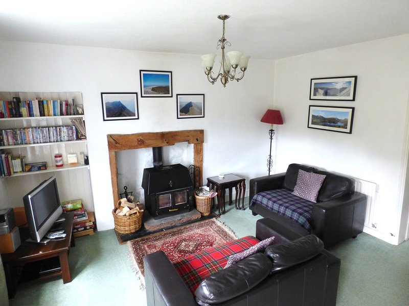 Living room with woodburner, leather sofas and great views