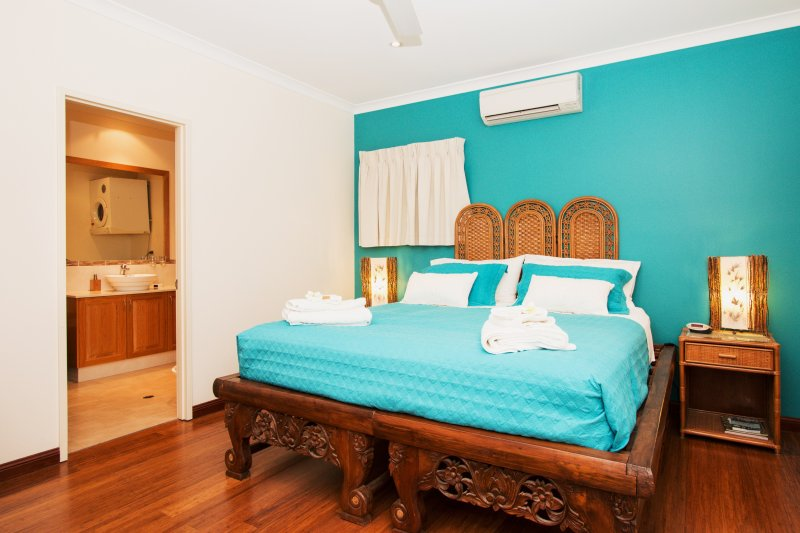 Upstairs Bamboo Suite with it's king sized carved teak bed