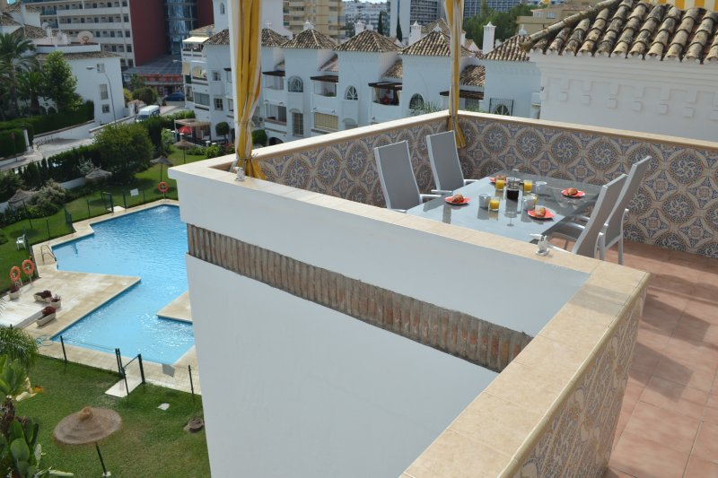 large terrace area overlooking the pool