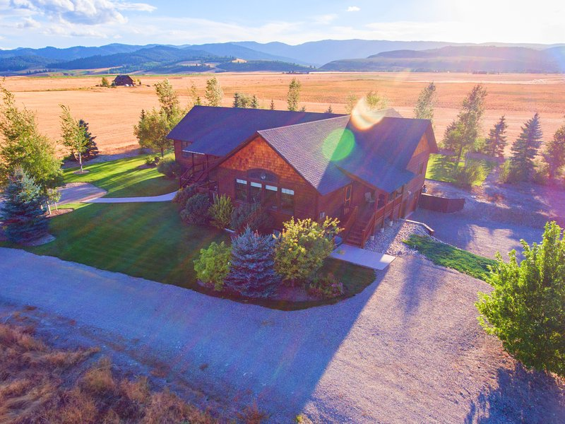 This beautiful country home is surrounded by mountain views.