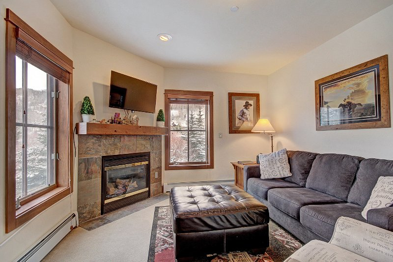 SkyRun Property - '201 Oro Grande' - Living Room - Cozy living room with a gas fireplace.