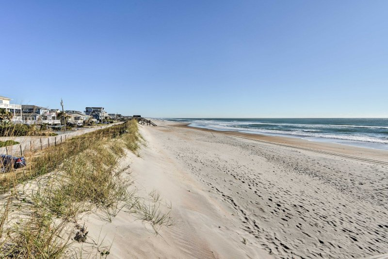 Spend the day sunbathing on the sand - A short walk away from the beach house that will soon feel like home!