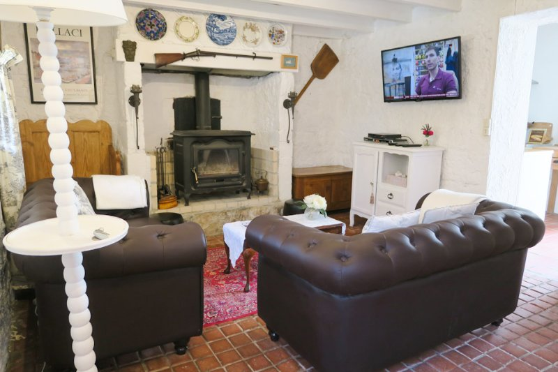 Lounge with flat screen TV & wood burner for chilly days