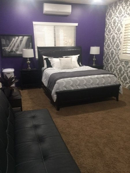 Large Bedroom with Queen Bed and Private Bathroom.
