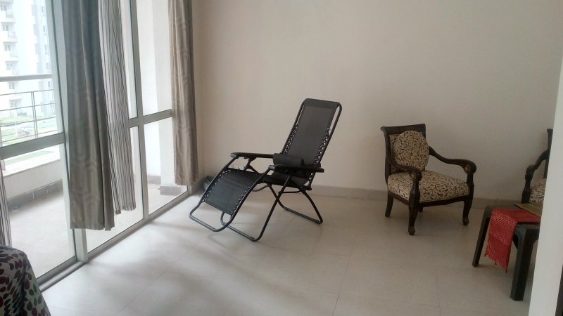 A spacious lobby with A.C, seating and an attached balcony overlooking the surroundings. Recliner.