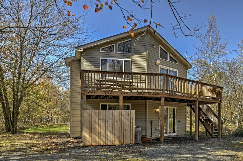 Endless adventures await you at this 5-bedroom, 3-bath vacation rental home in Blakeslee!
