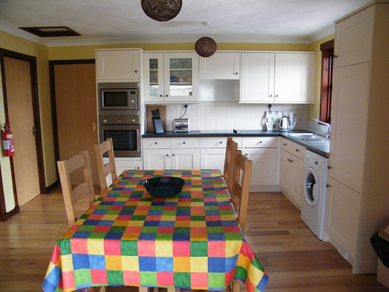 Kitchen with full size oven, hob fridge, washing machine and freezer