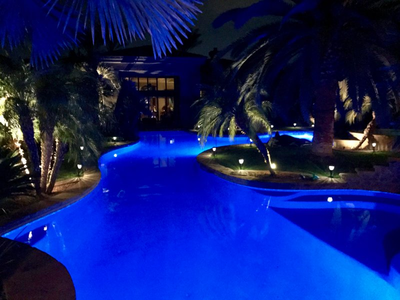 Oasis Lagoon pool at night.Changing color light wheel.