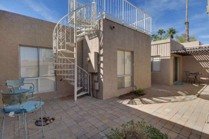Front patio of the home. The spiral staircase leads to the roof deck to enjoy some amazing views!