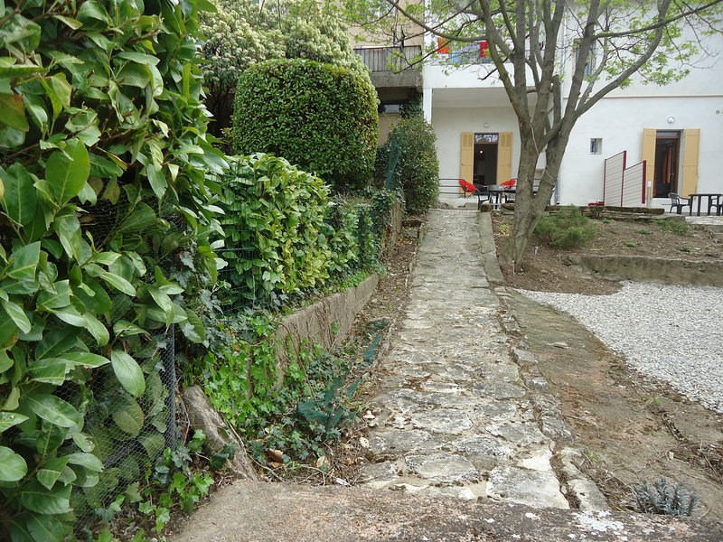 garden frontage driveway leading to the parking