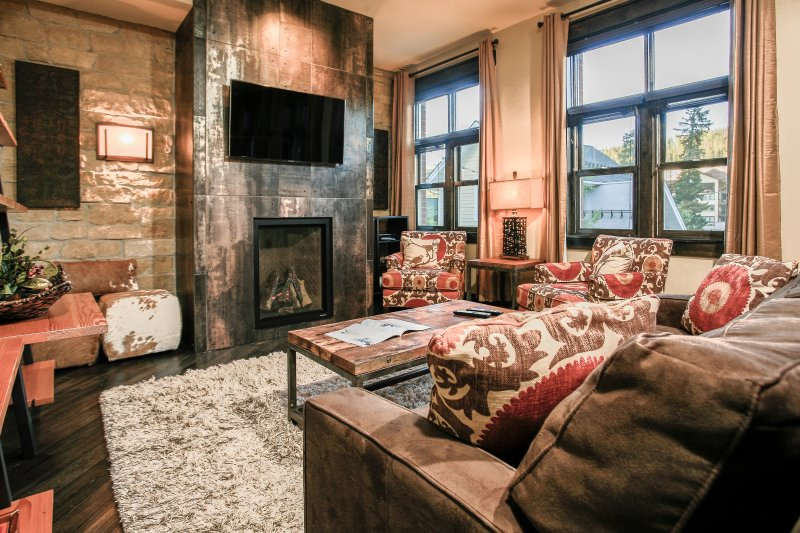 Huge lounge with gas fireplace and flatscreen TV.