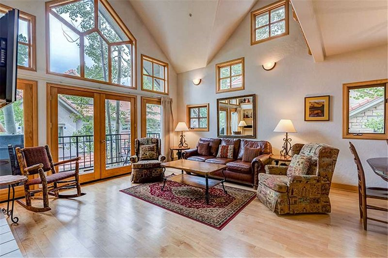 Living Room Boasts Vaulted Ceilings, a Gas Fireplace, and Flat-Screen TV