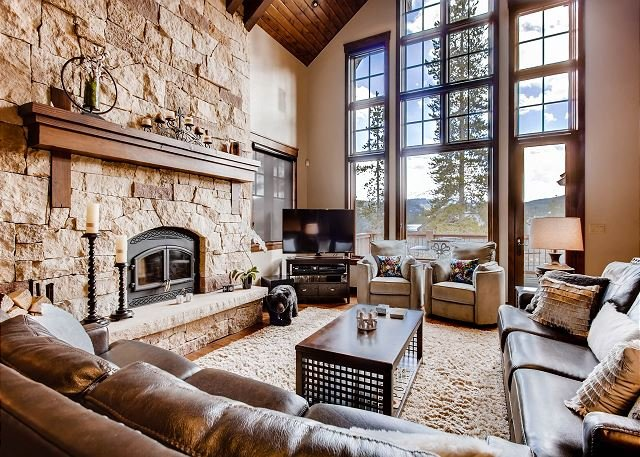 Brightly lit great room with mountain views