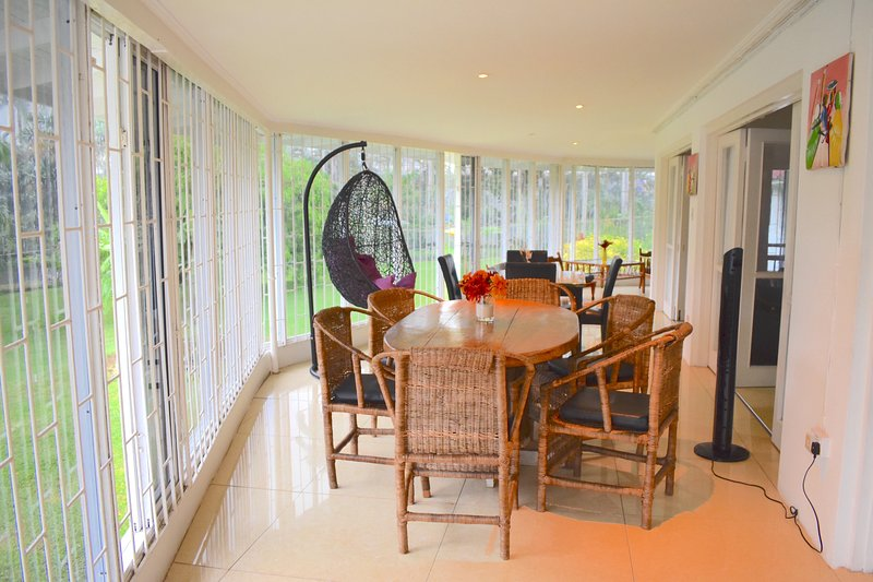 Stunning dinning area overlooking our swimming pool also fruited gardens with seating for 10 people