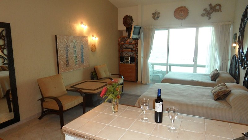 COMPLETE KITCHEN,COMFORTABLE BEDS,REVERSE OSMOSIS WATER SYSTEM,WIFI,SMART TV,FRONT BALCONY
