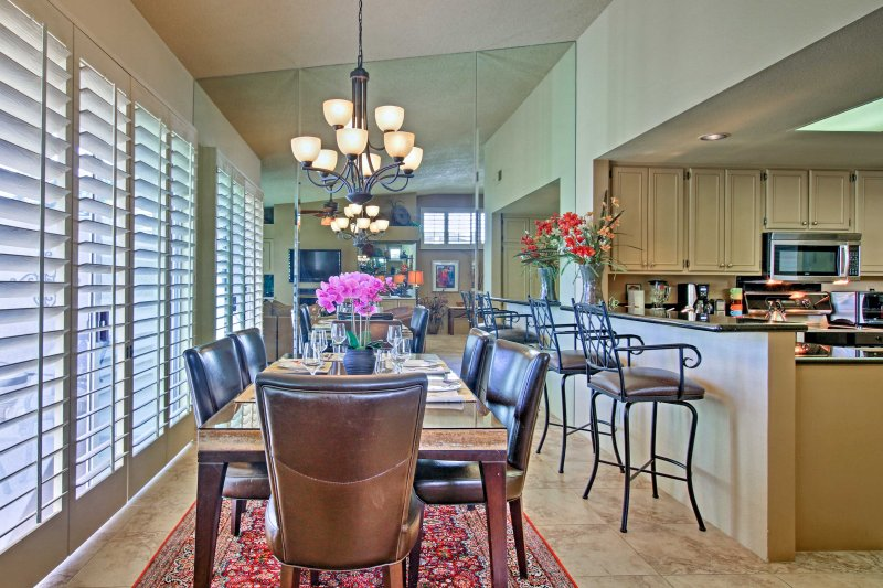 Enjoy meals at the 6-person dining table or 2-person breakfast bar.