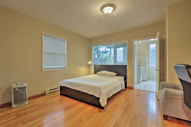 The cozy unit boasts a full-sized bed, hardwood floors and plenty of natural light.