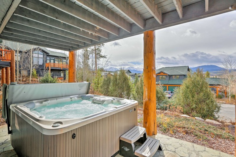 This luxury home boasts mountain views from the deck and patio w/private hot tub