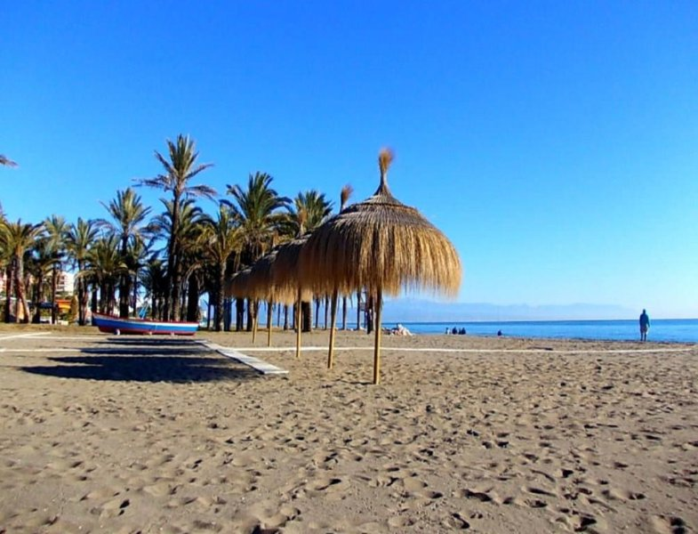 Torremolinos beach and promenade La Carihuela  60m from spacious 4 bedroom apartment .