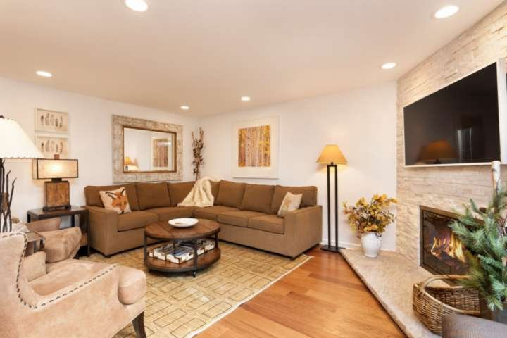 Relax by the contemporary gas fireplace and enjoy entertainment on the flat screen tv at the end of the day