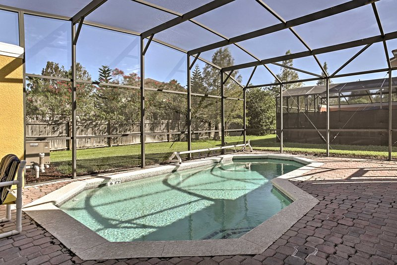 The townhome boasts a private pool in the enclosed lanai!