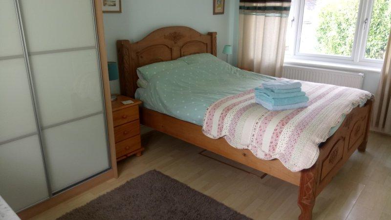 Queen size bedroom with en-suite shower room.